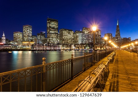 Romantic view of San Francisco at night from Pier 7. - stock photo