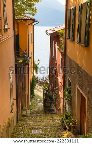 Romantic view of the Italian Lake Como from one of the very narrow streets of Varenna town, Italy, Europe - stock photo