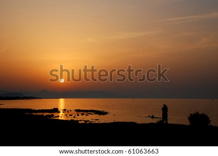 Romantic view of the sunset on sea. On Crete. - stock photo