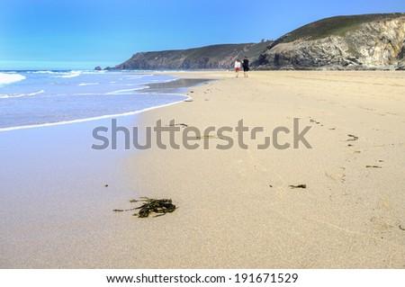 Romantic walk along porthtowan beach - stock photo
