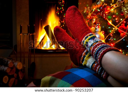 romantic winter evening by the fireplace Christmas and Christmas tree - stock photo