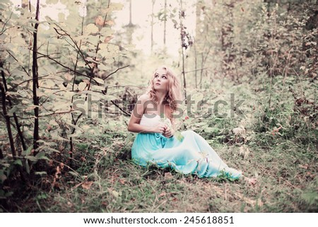 romantic woman in fairy forest - stock photo