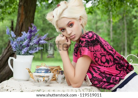 Romantic woman on a picnic in a fairy forest. Outdoors. - stock photo
