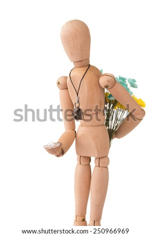 Romantic Wooden people hold the flower and engagement ring on White Isolated Background - stock photo