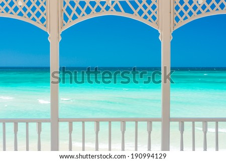 Romantic wooden terrace with a view of a tropical beach in Cuba - stock photo