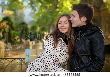 Romantic young couple at sunny autumn day - stock photo