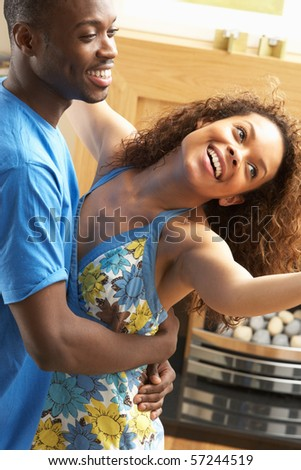 Romantic Young Couple Dancing Together In Living Room - stock photo
