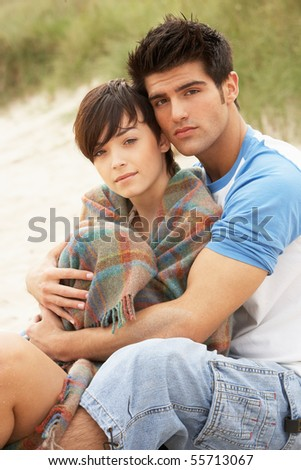 Romantic Young Couple Embracing On Beach - stock photo