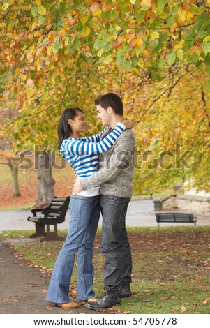 Romantic Young Couple In Autumn Park - stock photo