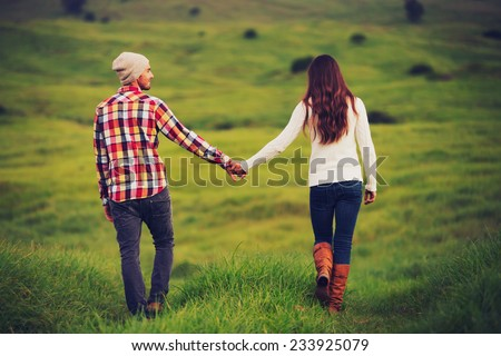 Romantic Young Couple in Love Outdoors in the Countryside - stock photo