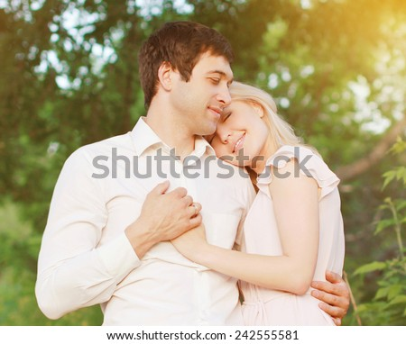 Romantic young couple in love outdoors, warm tender feelings - stock photo