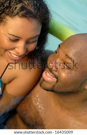 Romantic young couple in the swimming pool - stock photo