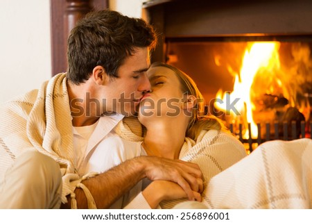 romantic young couple kissing in living room  - stock photo