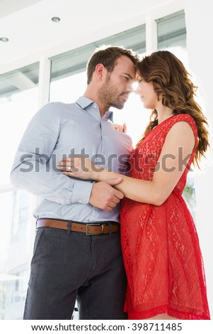 Romantic young couple looking at each other and embracing - stock photo