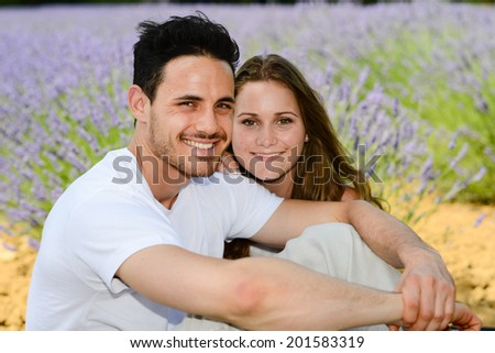 romantic young couple, man and woman during summer holiday having fun in lavender field in provence south France