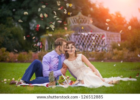 Romantic young couple picnic together in the summer park