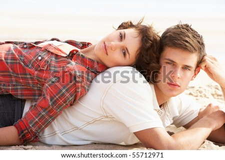Romantic Young Couple Relaxing On Beach - stock photo