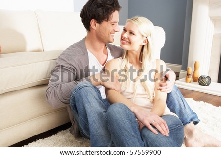 Romantic Young Couple Relaxing Together At Home - stock photo