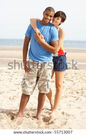 Romantic Young Couple Standing On Beach - stock photo