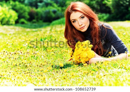 Romantic young woman  outdoors at a summer day. - stock photo