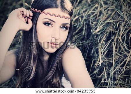 Romantic young woman posing outdoor. - stock photo