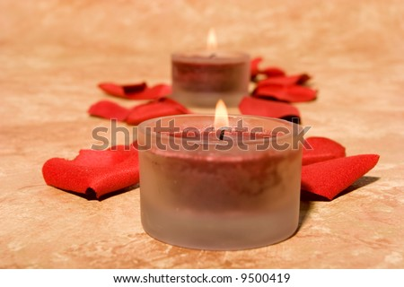 Romatic scented candles and rose petals