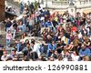 ROME - APRIL 8: People sit on famous Spanish Steps on April 8, 2012 in Rome, Italy. According to Euromonitor, Rome is the 3rd most visited city in Europe (5.5m international tourist arrivals 2009) - stock photo