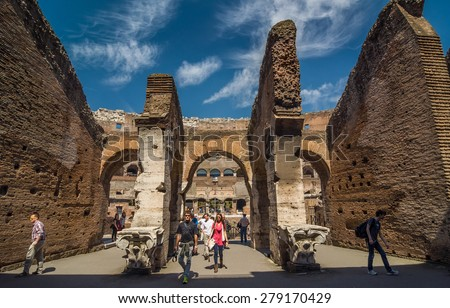 ROME - APRIL 17, 2013: Tourists in the interior of The Colosseum (Coliseum) also known as the Flavian Amphitheatre on a sunny spring day. Rome, Italy. - stock photo