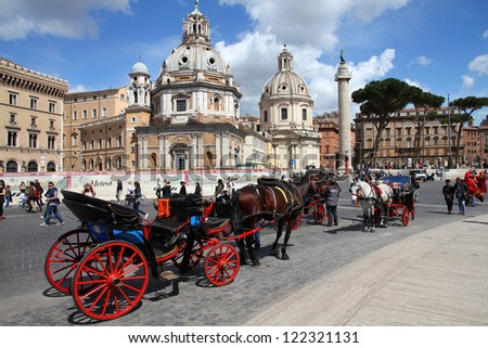 ROME - APRIL 8: Tourists walk in Piazza Venezia on April 8, 2012 in Rome. According to Euromonitor, Rome is the 3rd most visited city in Europe (5.5m international tourist arrivals 2009) - stock photo