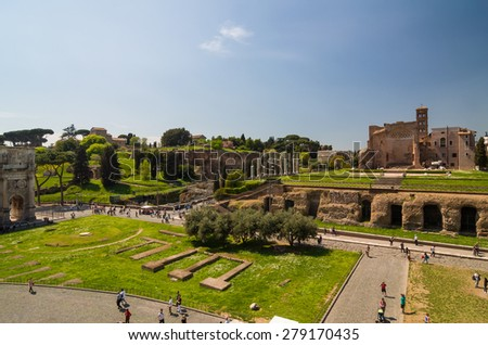 ROME - APRIL 17, 2013: Tourists walk near The Arch of Constantine and Colosseum (Coliseum) and Forum Romanum on a sunny spring day. Temple of Venus and Roma seen from the Colosseum. Rome, Italy. - stock photo