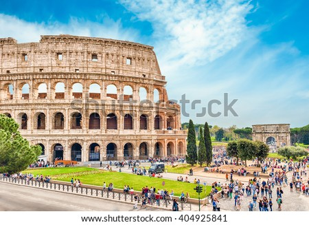 ROME - APRIL 2, 2016 - Tourists walking by the Colosseum in Rome, April 2, 2016. The Colosseum is an iconic symbol of Imperial Rome. In 2007 the complex was included among the New7Wonders of the World - stock photo