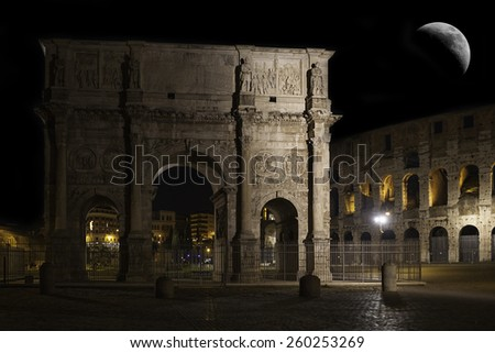 Rome, Arch of Constantine and Colosseum in the background - stock photo