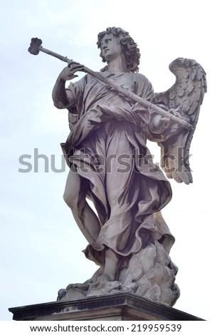 ROME - AUGUST 27, 2014: Bernini's marble statue of angel against the background of sky on Castel Sant'Angelo Bridge in Rome , Rome, Italy - stock photo