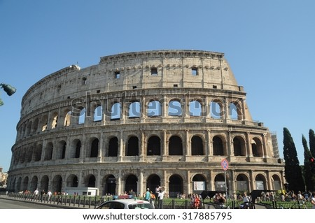 ROME - AUGUST 30: Colosseum exterior on August 30, 2015 in Rome, Italy. The Colosseum is one of the most attractive ancient buildings in Rome. Many tourists are coming to Rome for seeing this arena.