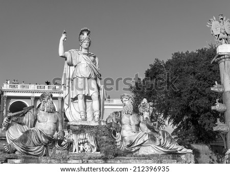 ROME - AUGUST 22: Fountain of Dea Roma, sculptured by Giovanni Ceccarini (1814-1823). In the background some tourists stick out from Villa Borghese terrace on August 22, 2014 in Rome, Italy. - stock photo