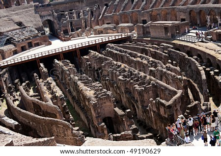 ROME - AUGUST 30: Interior of Roman Coliseum on August 30, 2009 in Rome, Italy. The Roman Coliseum is one of the most popular tourist attractions, receiving millions of visitors annually