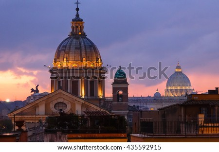 Rome City night illuminated  view  from top of Spanish Steps with Sant Ambrogio e Carlo al Corso (or San Carlo al Corso) basilica top and Saint Peter Basilica dome (behind), Italy. - stock photo