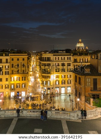 Rome City, the capital of Italy in a summer night with a colorful panoramic sunset aerial view toward the city shopping street, Barcaccia Fountain from Spanish steps under dramatic sky crescent moon