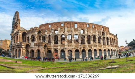 ROME - DECEMBER 21: Coliseum exterior on December 21, 2013 in Rome, Italy. The Coliseum is one of Rome's most popular tourist attractions with over 5 million visitors per year.