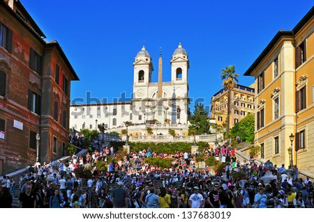 ROME, ITALY - APRIL 18: A crowd in Piazza di Spagna, the Spanish Steps, the stairway of Trinita dei Montei, on April 18, 2013 in Rome, Italy. Piazza di Spagna is one of the most famous place in Rome - stock photo