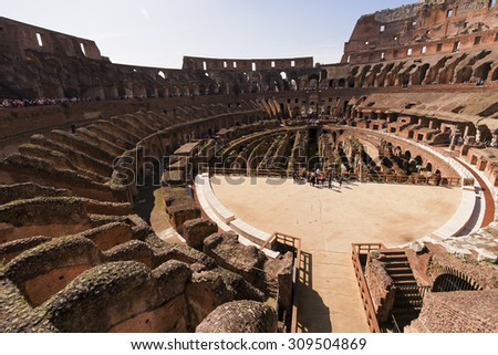Rome, Italy - April 7, 2013: Ancient Roman Coliseum sees around 4 million tourists a year and is the world's 39th most popular destination - stock photo