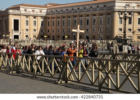 Rome, Italy - APRIL 10, 2016: Groupe of pilgrims going to St Peter basilica, Vatican City, St Peter square, Rome, Italy - stock photo