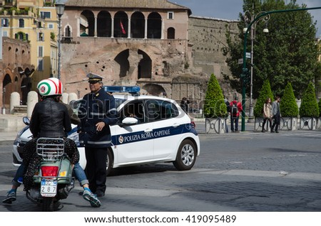 ROME, ITALY - APRIL 26: Italian policeman directis traffic at the street Via dei Fori Imperiali on April 26, 2016 in Rome