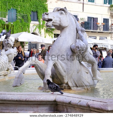 ROME, ITALY - APRIL 19, 2015: Neptune Statue in Piazza Navona. The Fountain of Neptune is a fountain in Rome, on April 19, 2015. Piazza Navona is one of the most famous squares of Rome - stock photo
