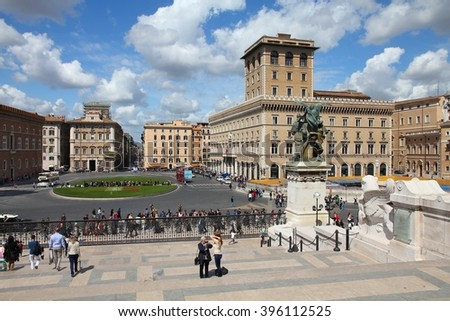 ROME, ITALY - APRIL 8, 2012: People walk in Piazza Venezia in Rome. According to official data Rome was visited by 12.6 million people in 2013. - stock photo