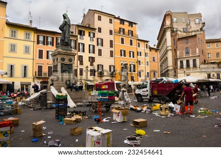 ROME, ITALY - APRIL 19: Piazza Campo de Fiori and Giordano Bruno statue in April 19, 2012 in Rome Italy. The trash made after the flower market that took place in the square - stock photo