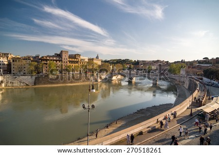 ROME, ITALY - APRIL 16, 2013: Ponte Vittorio Emanuele II across the Tiber river. Aerial view from the Mausoleum of Hadrian, usually known as Castle of the Holy Angel (Castel Sant'Angelo). Rome, Italy. - stock photo