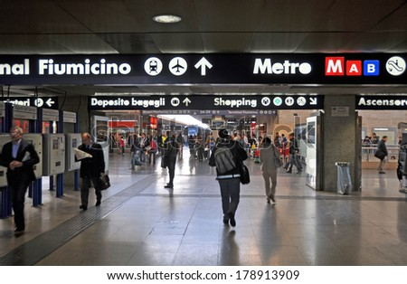 ROME, ITALY - APRIL 11, 2011: Termini underground train station with signs for Fiumicino Airport. Thousands of tourists arrive in Rome by train in the weeks leading up to the Easter celebrations. - stock photo