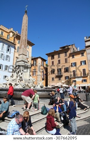 ROME, ITALY - APRIL 10, 2012: Tourists visit Piazza della Rotonda in Rome. According to Euromonitor, Rome is the 3rd most visited city in Europe (5.5m international tourist arrivals 2009) - stock photo