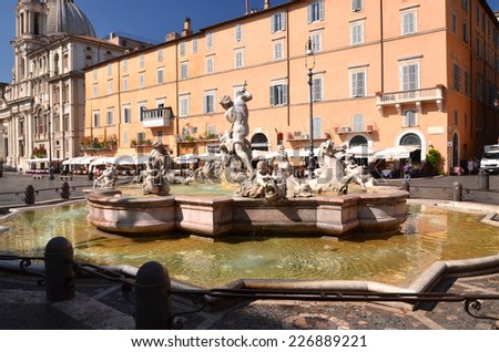 ROME, ITALY - AUGUST 22, 2014: Beautiful Fountain of Neptune on Piazza Navona in Rome, Italy. The fountain was sculpted by Giacomo della Porta in 1574. - stock photo